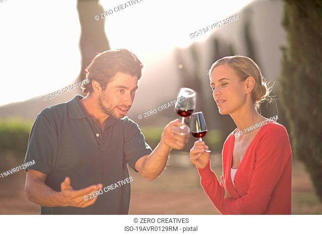 People tasting red wine