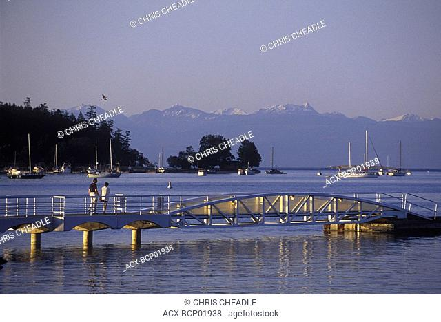 Nanaimo with people crossing bridge to public float, Vancouver Island, British Columbia, Canada