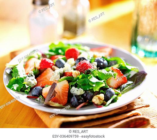 berry salad with blue cheese crumbles and walnuts
