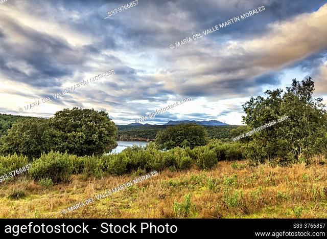 River Lozoya and clouds over the Sierra Cabrera on the background. Madrid. Spain. Europe