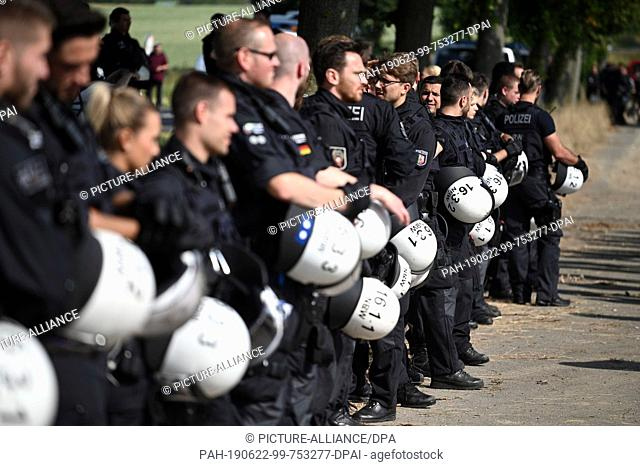 """22 June 2019, North Rhine-Westphalia, Keyebnberg: Policemen accompany a gathering of activists from the action alliance """"""""Ende Gelände"""""""" who are protesting at..."""