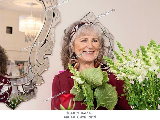 Senior woman shopping in florist shop