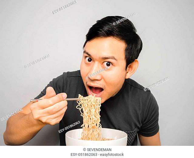 Asian man feel surprise with how delicious instant noodle is