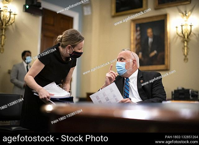 Dr. Robert Redfield, Director of the Centers for Disease Control and Prevention , speaks with an aide before a US House Appropriations Subcommittee hearing on...