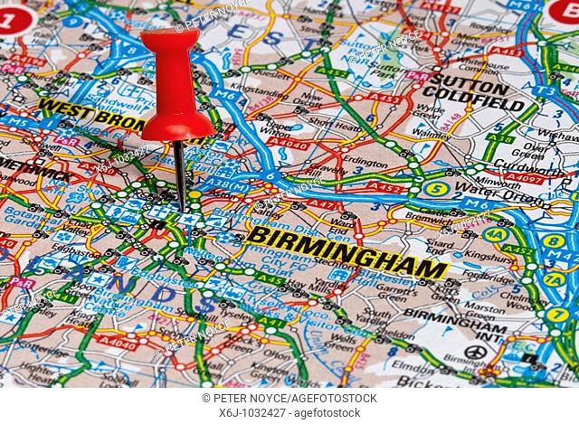 red map pin in road map pointing to city of Birmingham