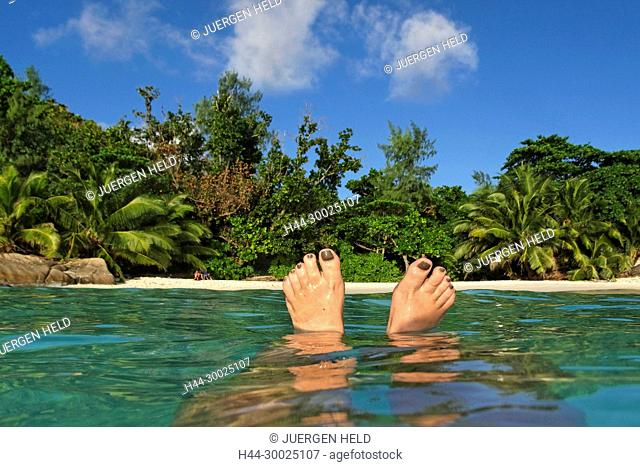 Womens Feet , Spit Level, Anse Lazio, Baie Sainte Anne district, Island of Praslin, Seychelles, Indian Ocean, Africa