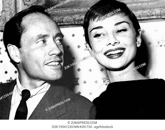 Dec. 30, 1954 - London, England, U.K. - Actress AUDREY HEPBURN with husband MEL FERRER during visit in London. Magical screen presence, fashion arbiter