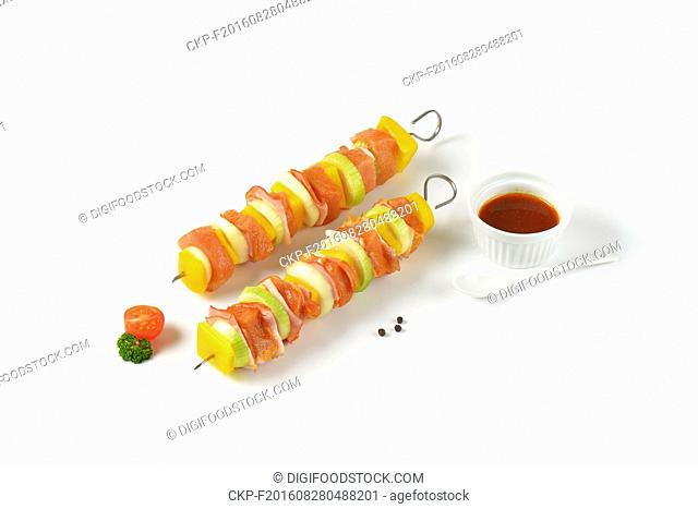 Raw pork skewers glazed with honey marinade