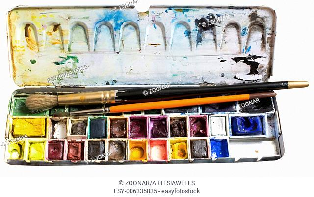 Watercolor box and brushes isolated on white