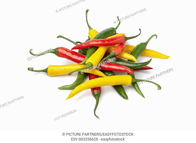 Red, yellow and green chili peppers on white background