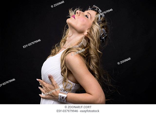 Beautiful greek blonde woman, mythology, dressed in white silk dress and laurel wreath handmade with silver