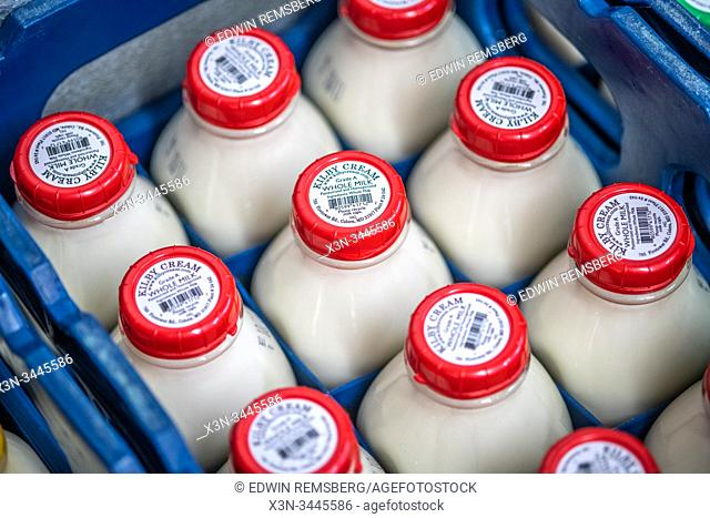 Freshly sealed milk sitting neatly in crates, Colora, Maryland, USA