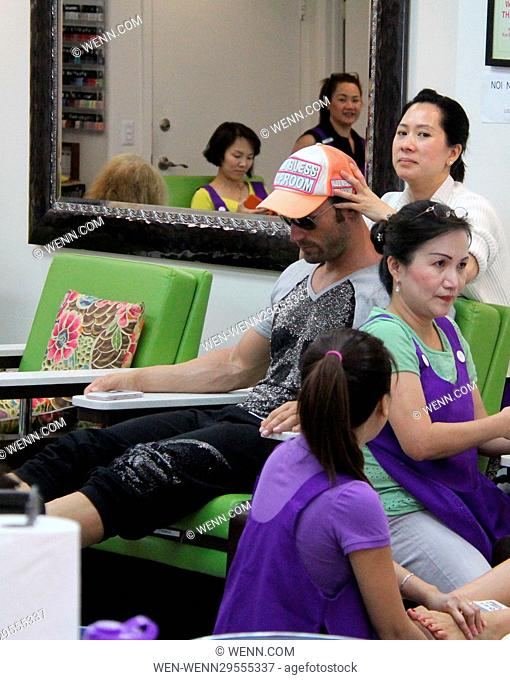 Bastian Yotta visits the spa with his girlfriend to get their nails done Featuring: Bastian Yotta Where: Beverly Hills, California