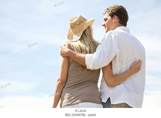 rear view of young couple standing in embrace