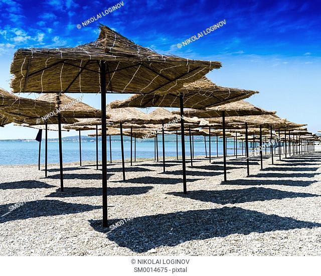 Horizontal vivid beach umbrellas background backdrop
