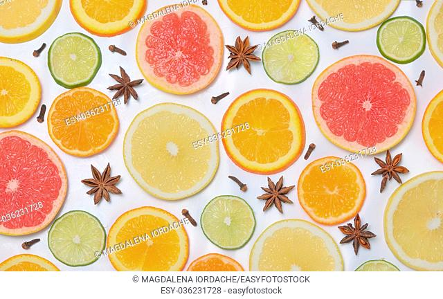 Background with citrus fruit slices, anise star and Clove