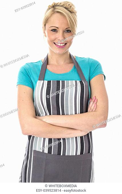 Model Released. Attractive Young Woman Posing in a Kitchen Apron