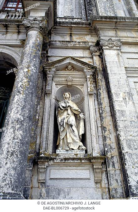 Statue of St Elizabeth of Hungary on the facade of the Basilica of the Mafra National Palace, Historical Province of Extremadura, Lisbon