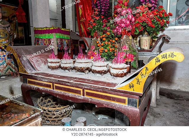 Yantou, Yongjia, Zhejiang, China. Altar Covered with Incense Ash inside a Buddhist Temple