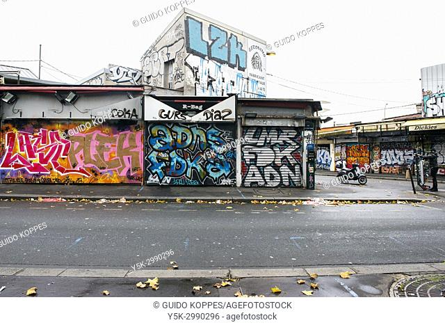 Paris, France. Closed Shops, Stores and Commerical BUildings with blinds shut and streetart. Shops in this district generally open at noon ad attract visitors...