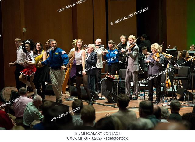This on-stage shot reveals a very musical scene inside Houston's Jones Hall, as the Irish band Chieftains joined with the Houston Symphony and other musicians...