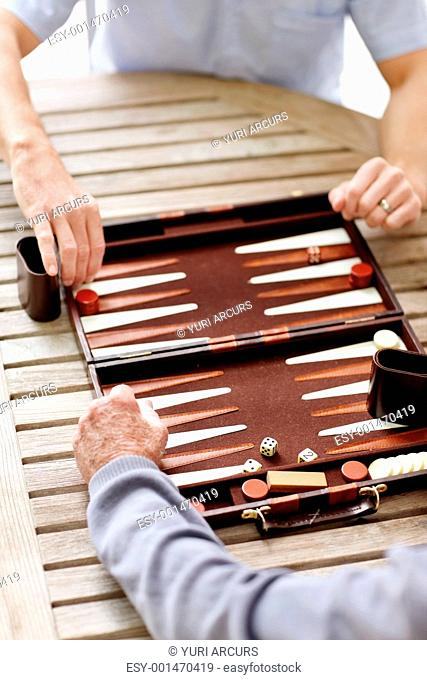 Portrait of two man playing a game of backgammon