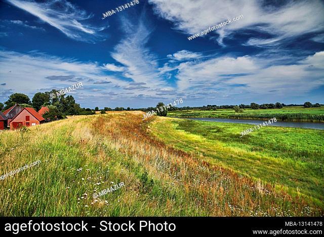Elbe valley floodplain in Lower Saxony, Germany, biosphere reserve, Radegast, dike at Radegaster Haken with homestead