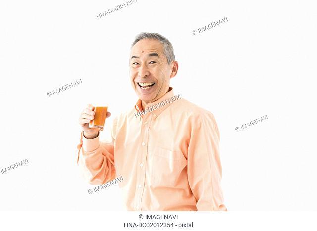 Senior man having juice