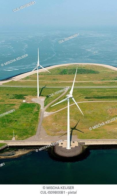 Aerial shot of two wind turbines mounted on the Oosterschelde flood barrier, Vrouwenpolder, Zeeland, Netherlands
