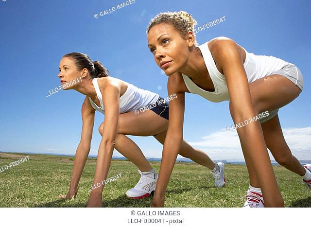 Two Woman on their Mark About to Race  Cape Town, Western Cape Province, South Africa