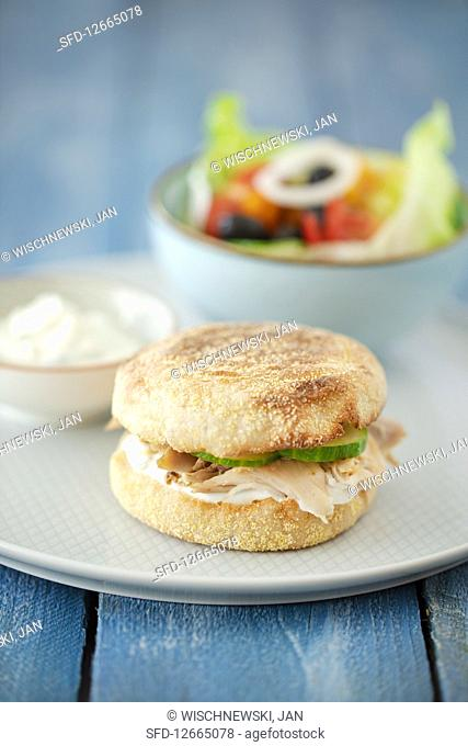 A toastie burger with chicken, mint quark and Greek salad
