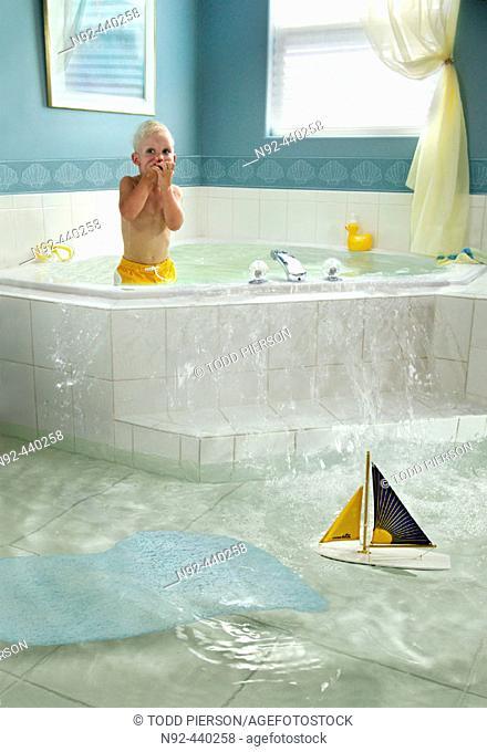 4 year old boy overflowing bathtub