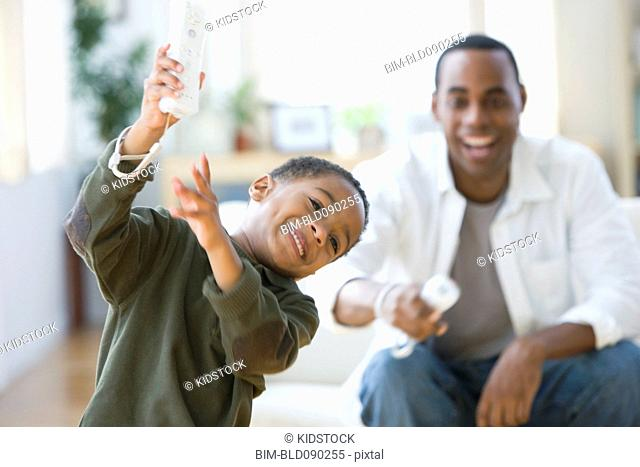 African American father and son playing video game