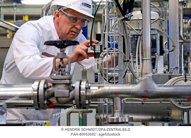 ThyssenKrupp employee Bert Stoffels guards the new biotechnology plant in Leuna, Germany, 10 July 2013. The facility serves to test fermentation processes on an...