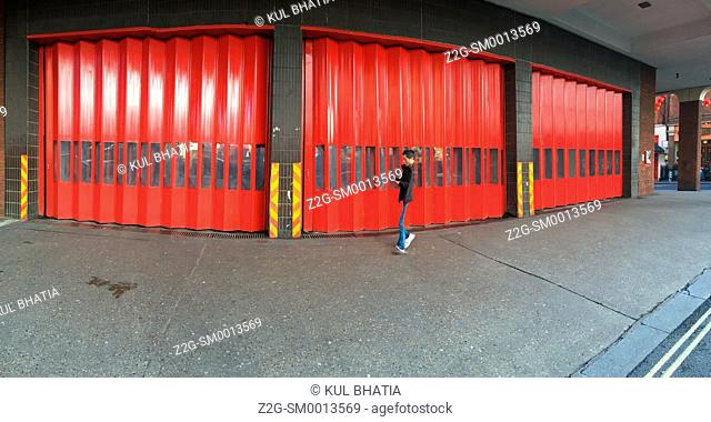 Red shutters of the fire station, the West End, London, England, a panoramic view