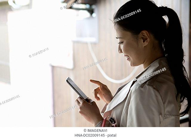 Young Japanese woman using smartphone