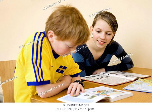Boy and girl studying