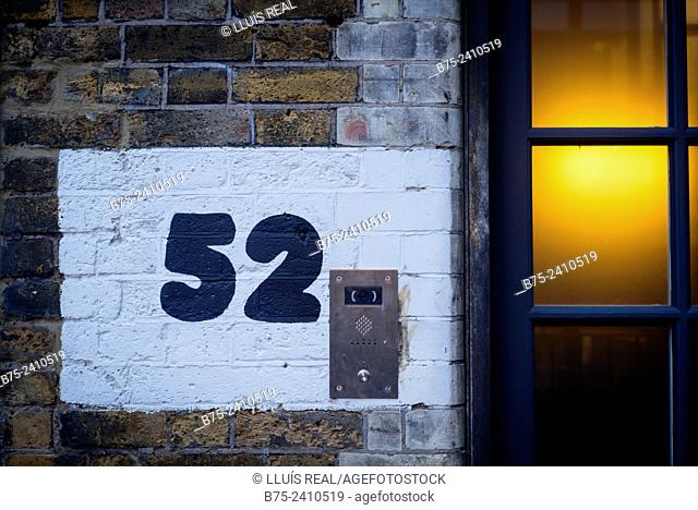 Number 52 handwritten on a brick wall of a building in Hoxton square, London, England, UK, Europe