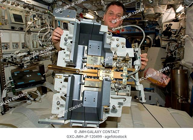 NASA astronaut T.J. Creamer, Expedition 22 flight engineer, works with the Japanese Experiment Module Remote Manipulator System (JEMRMS) Small Fine Arm (SFA) in...