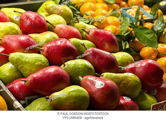Seattle, Washington: Red and green pears artfully arranged for the holiday at Pike Place Market