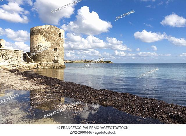 Scenic view of Saline tower against the scattered clouds at midday. Stintino, Sardinia. Italy