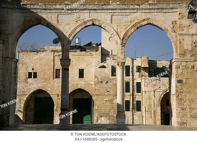 Ancient columns frame buildings near the Dome of the Rock on Temple Mount in the Old City of Jerusalem