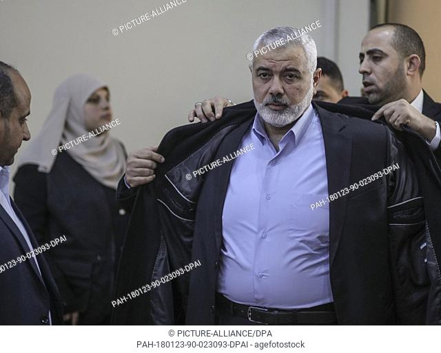 Chairman of the political bureau of the Hamas Islamist movement, Ismail Haniyeh (C), arrives for a press conference, concerning the latest political...