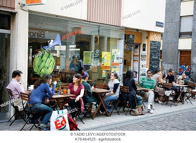 Sep 2008 - People sitting at an outdoors cafe on Grand Rue, Strasbourg, Alsace, France