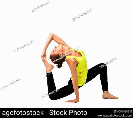 Slim girl doing yoga back bending gracefully indoors isolated on white