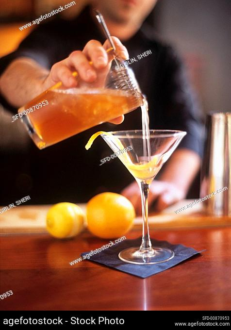 Straining a cocktail (The Journalist) into a glass