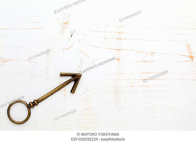 metal arrow on white wood background