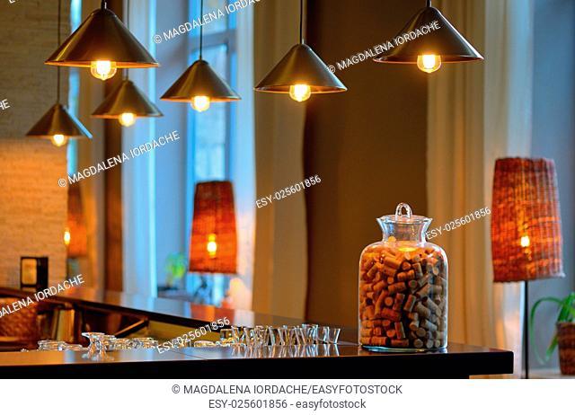 various old wine bottle corks in a glass vase at bar