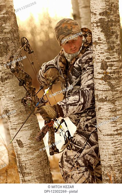 Bowhunter Hunting Big Game In Winter
