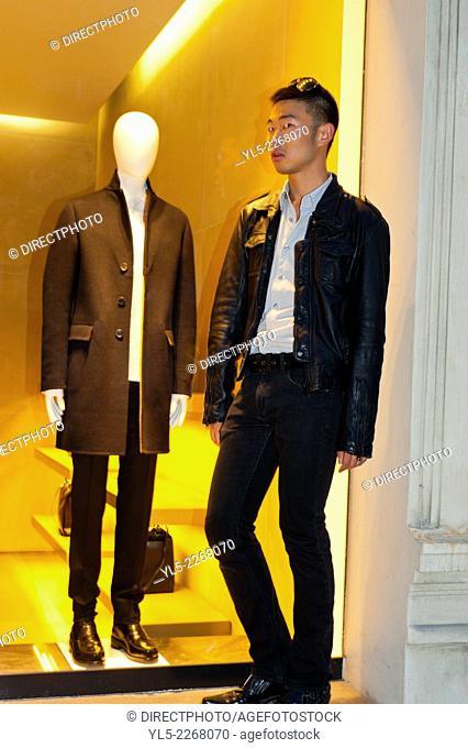 Paris, France, Young Chinese Man Posing Outside Luxury Shop Window, Night, Avenue Montaigne